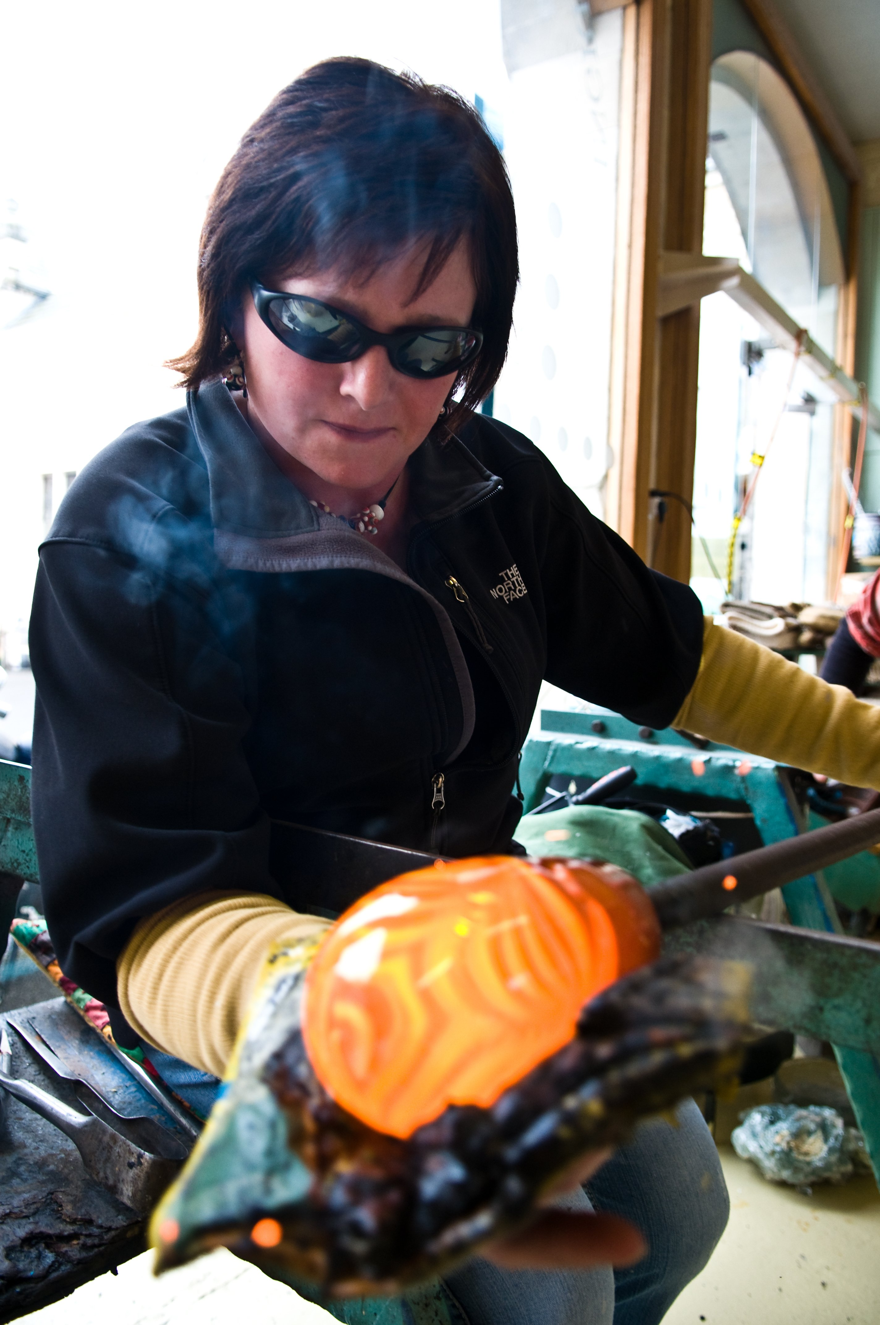 Ingrid glassblowing in her studio at Thoresby