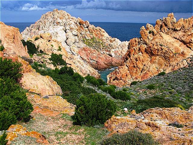 Wolken, Meer und Granit - farbenprächtige Symbiose