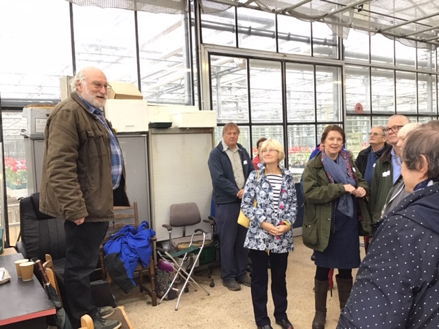 NAAS President de Rotheschild welcoming members and other visitors to his glasshouse.