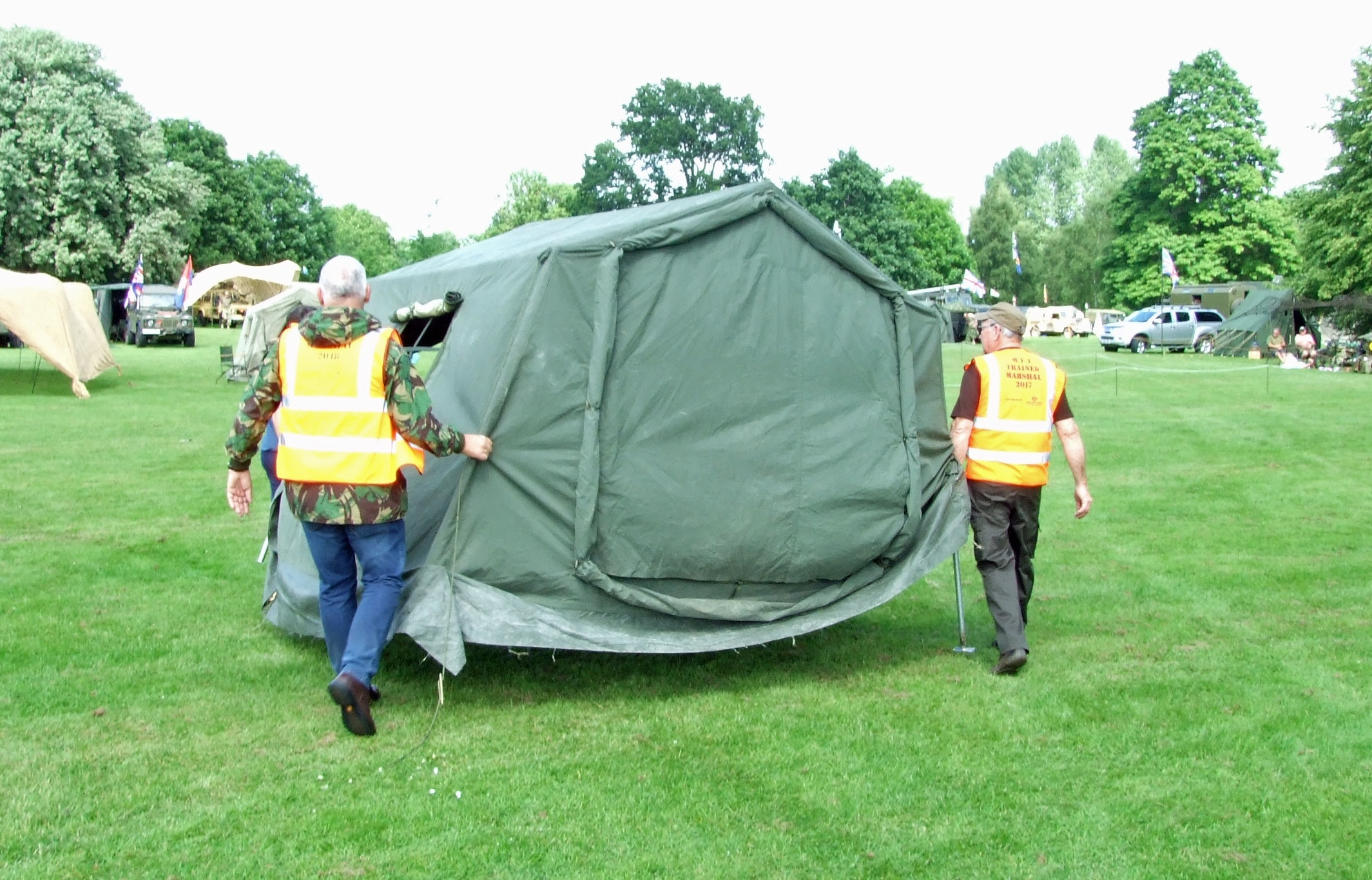 This tent was pitched in the wrong place,  so marshals walked it to a new site