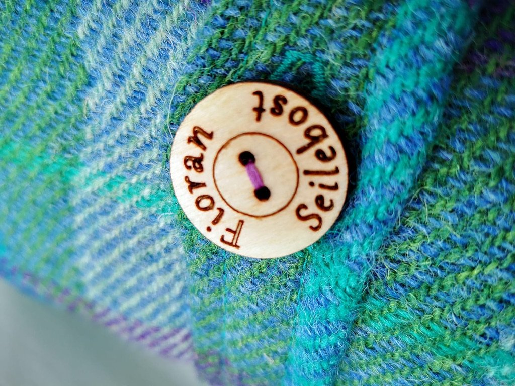 Cushion buttons just for us.  Harris Tweed cushions.