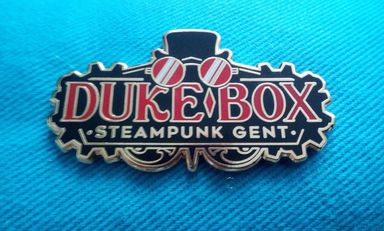 Duke Box hat and goggles badge