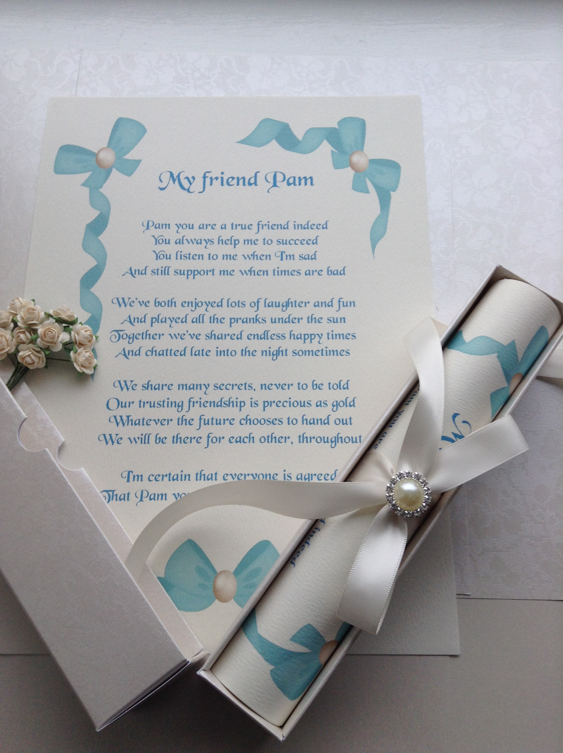 A4 scroll with pearl look embellishment.