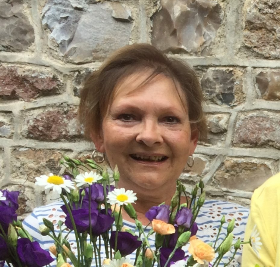 """Jackie was, as always, revved up and ready to go which makes it a lot of fun. We were given lots of useful tips on buying flowers and preparing them for arranging. I was really pleased with the end result."""