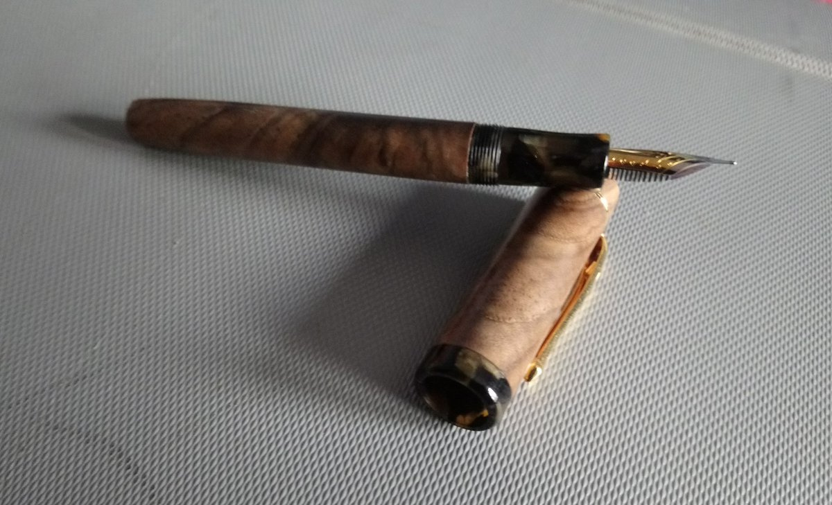 Fountain pen made from English Walnut with top off showing gold nib