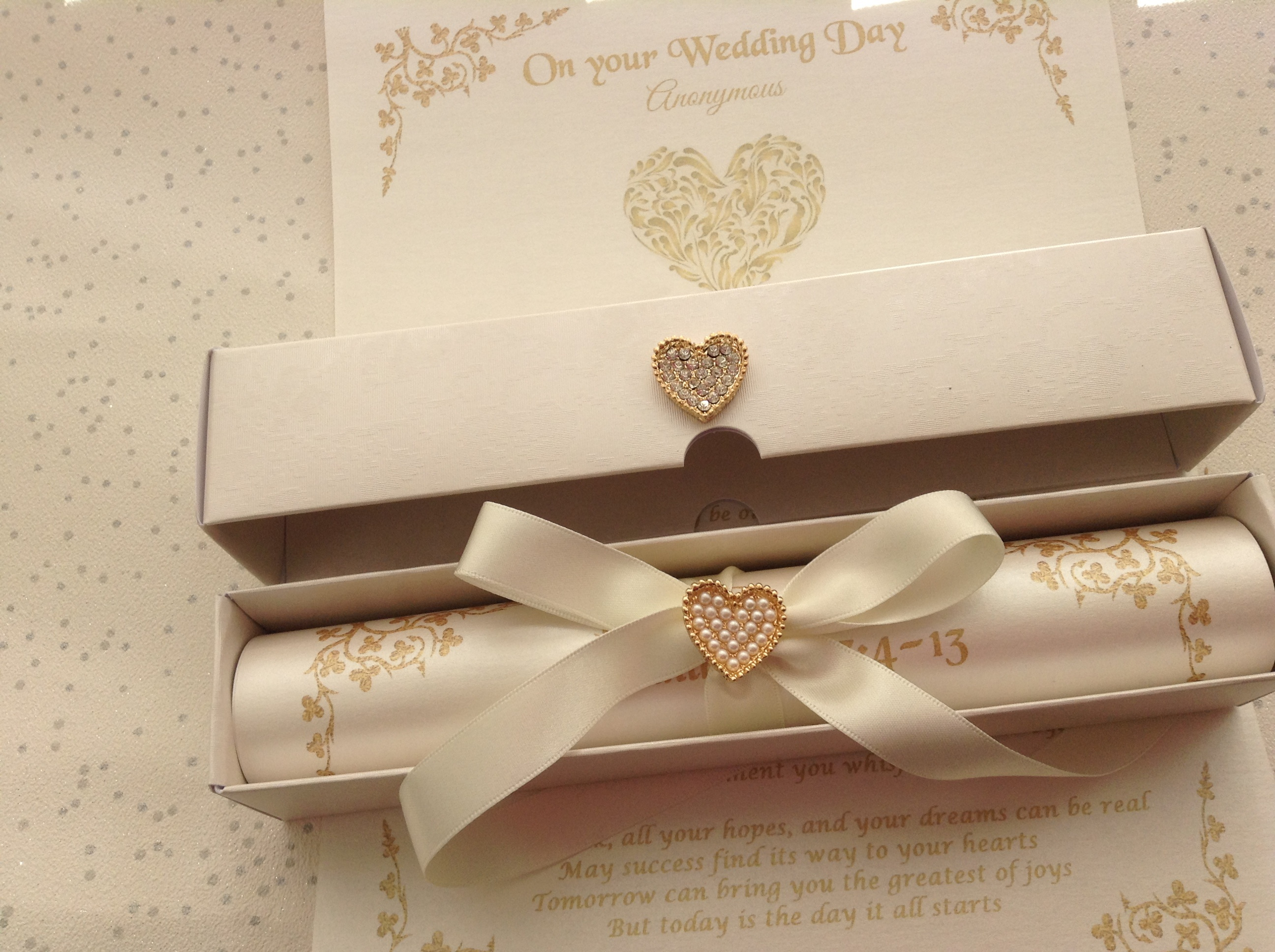 A4 scroll showing a gold pearl heart embellishment